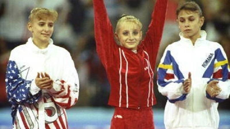 Tatiana Guțu (în roșu) le-a învins pe americanca Shanon Miller și românca Lavinia Miloșovici la Barcelona 1992. Foto: Youtube