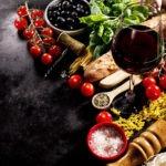 Tasty fresh appetizing italian food ingredients on dark backgrou